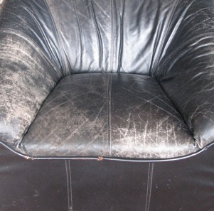 worn black leather chair