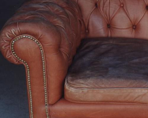 leather chesterfield couch before restoration
