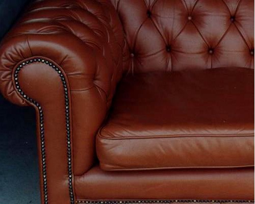 leather chesterfield couch after restoration