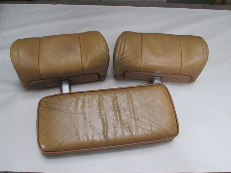 leather headrests and console lid before restoration