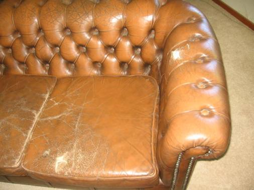 Worn Leather Couch Showing Cracks